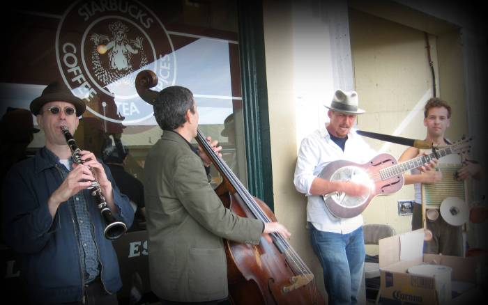 Seattle has a great selection of street performers & musicians; some of the very best that perform at Pikes Place.  Here, a bluegrass band entertains just outside another landmark, the original Starbucks.