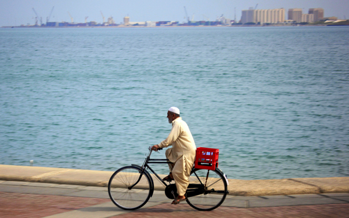 Cyclist spotted, along the Corniche (photo credit: Kate Harris, IISD Earth Negotiations Bulletin)