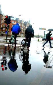 Rain or shine... in Copenhagen, it is done by bike