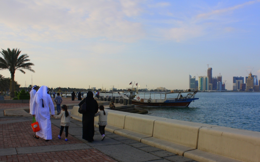 Familes stroll along the Corniche Bay on a long & wide pedestrian cooridor