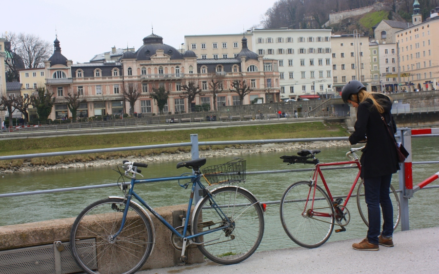Safety first: a helmet-wearing cyclist locks her bike by the Salz River