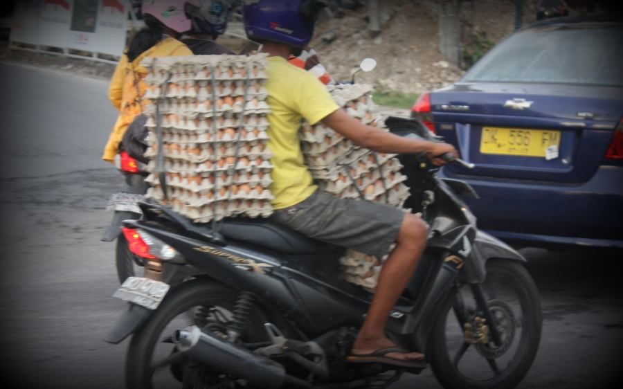 Whoever said that eggs were fragile? This guy dares to adventure into rush hour traffic...