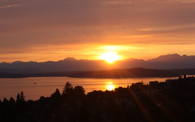 Bliss: sitting on my parents' balcony in West Seattle, staring off at the Olympics and Puget Sound on a warm summer's night. Seattle rain? Not here!