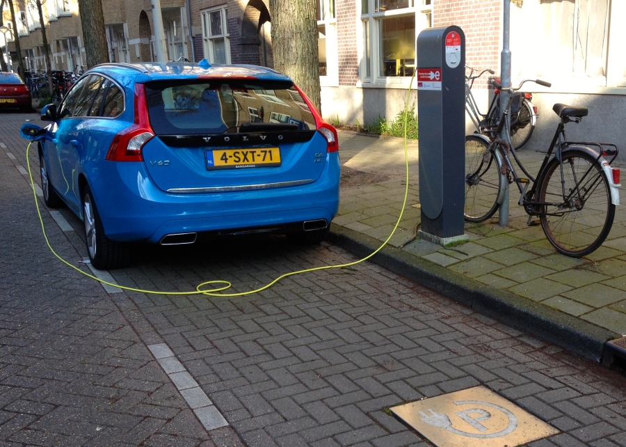 As a half-Swede, I'm proud to find a bright blue electric  Volvo often charging on my Amsterdam street corner. (A quick photo, as I cycle by, already late to catch my train to work!)