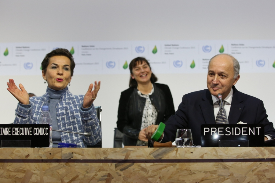 UNFCCC Executive Secretary Christiana Figueres and COP 21/CMP 11 President Laurent Fabius, Foreign Minister, France, gavel the adoption of the Paris Agreement