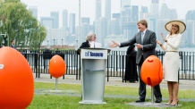 King Willem-Alexander, centre, and Queen Maxima of the Netherlands try out the new Tulpi chairs at a presentation on the Toronto Islands in Toronto on Friday, May 29, 2015. (Nathan Denette/THE CANADIAN PRESS)